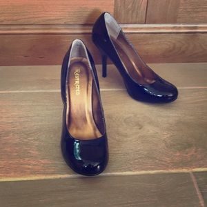 Restricted black real patent leather pumps